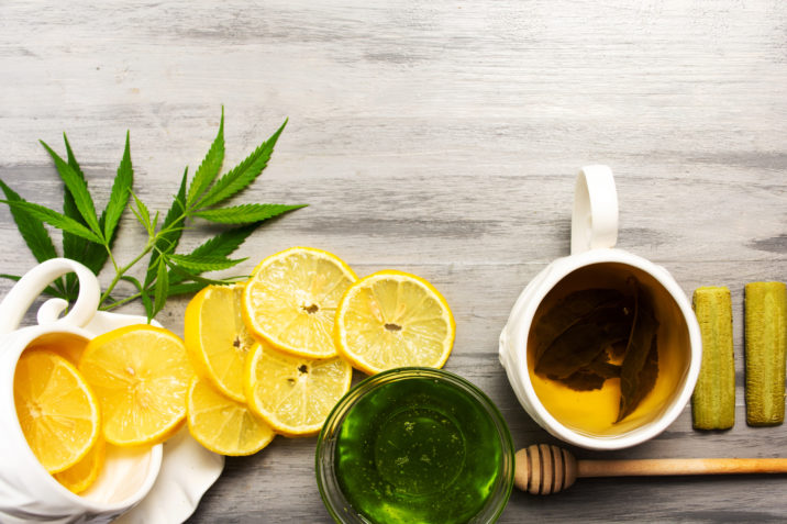 green tea, cannabis, lemon slices and honey